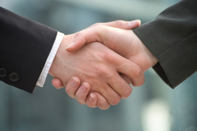 Shaking hands to demonstrate friendship with your new boss